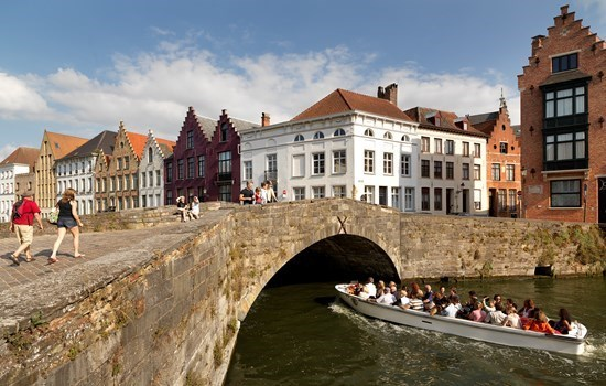 Boat passing under a bridge in Bruges, Belgium