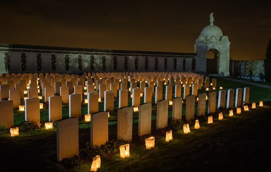 Candles in front of the thombstones of Tyne Cot cemetery, near Ypres, Belgium